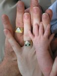 Image of three hands - dad, mom & baby